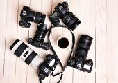 image of megapixel  - Modern cameras and cup of coffee on wooden table - JPG