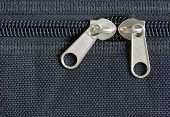 picture of zipper  - zipper on lock with black cloth background - JPG