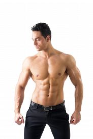 stock photo of hunk  - Handsome shirtless muscular man with elegant pants - JPG