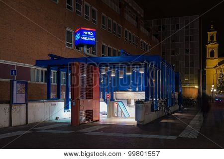 entrance of an amsterdam metro station at night