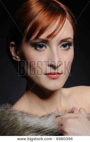 Beautiful Woman With Perfect Skin And Party Make-up Covered In Fur