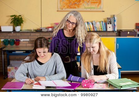 Teacher Checking On Her Students