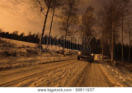4x4, suv, driving on a snowy winter road, sunset, trees and forest