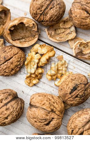 Raw walnuts on wooden bench