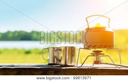 Making coffee or tea on a gas burner on the nature.