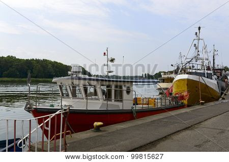 Fishing boats at the pier in Dziwnow, Poland.