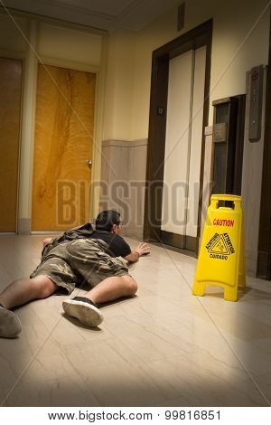 Young Man Trips And Falls in Front of Elevator