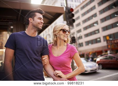 happy romantic young couple waiting to cross street in down town LA