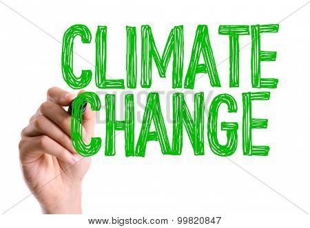 Hand with marker writing the word Climate Change