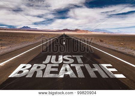 Just Breathe written on desert road