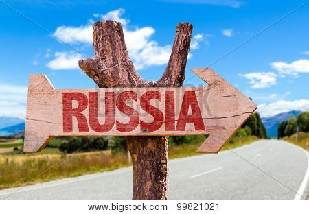 Russia wooden sign with road background