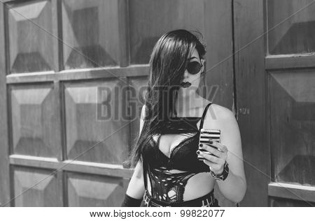 real punk girl with smartphone