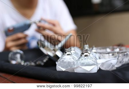 Selected Focus On Crystal Ball With Woman And Glue Gun