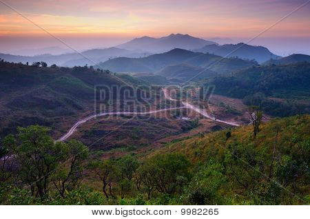Landscape Of Sunrise Over Mountains In Kanchanaburi,thailand