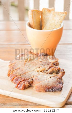 Pork Steak On Wooden Plate
