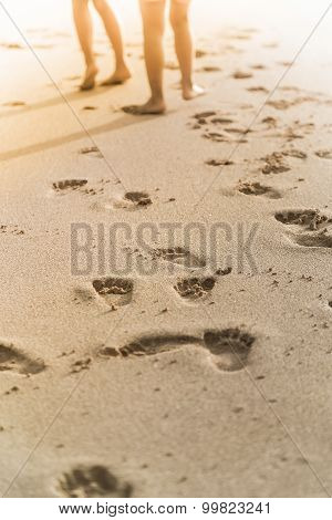 People Foot Prints On The Beach Sand
