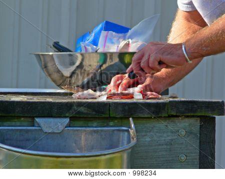 Man Filleting Fish