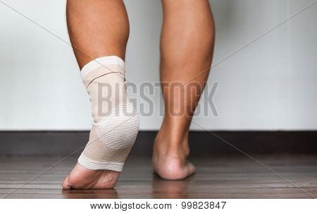 Injured Ankle And Foot Wrapped In Bandage