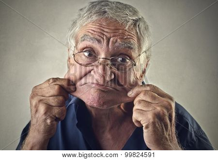 Elderly man making jokes