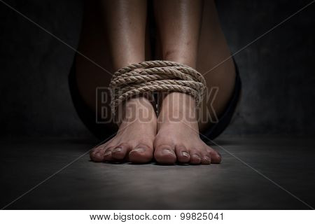 Shot Focus Of Feet Of A Missing Kidnapped, Abused, Hostage, Victim Woman Tied Up With Rope In Emotio