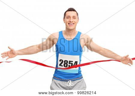 Male runner with a race number on his chest, crossing the finish line isolated on white background
