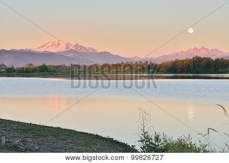 Full Blue Moon Over Mt. Baker And Three Sisters Mountain