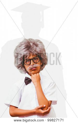 Pupil dressed up in wig against silhouette of graduate