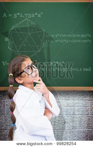 Cute pupil dressed up as scientist against green