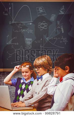 Pupils using laptop against teal, blue