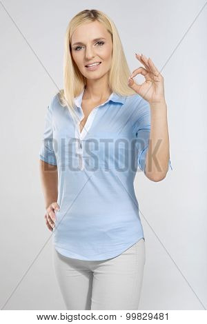 woman with okay gesture