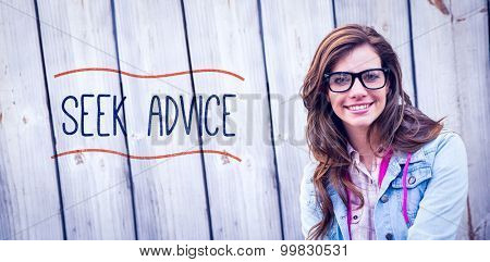 The word seek advice against pretty woman smiling at camera
