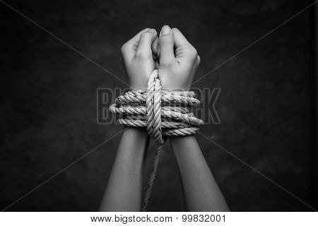 Hands Of A Missing Kidnapped, Abused, Hostage, Victim Woman Tied Up With Rope In Emotional Stress An