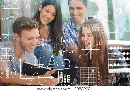 math against happy students looking at book outside on campus