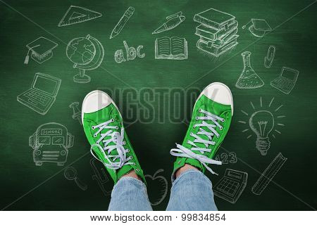 Casual shoes against green chalkboard