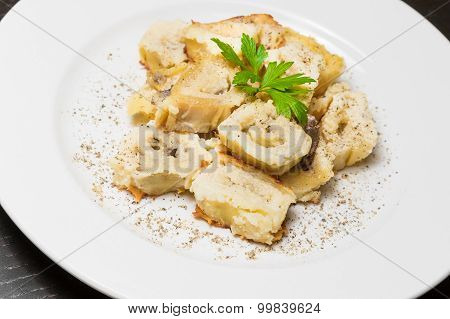 Detail Of Dish Of Italian Swivels Pasta With Porcini Mushrooms And Sauce Bechamel With Pepper