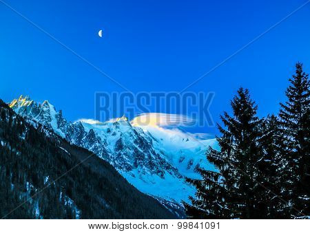 Moon Rises Above The Mount Blanc In France.