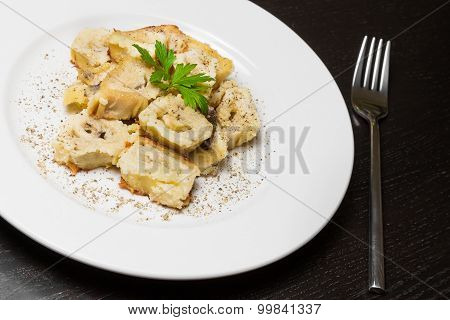 Detail Of Dish Of Italian Swivels Pasta With Porcini Mushrooms And Sauce Bechamel With Pepper Near F