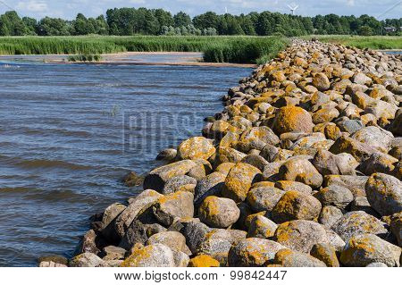 Ainazi North Pier Stones Covered By Yellow Moss