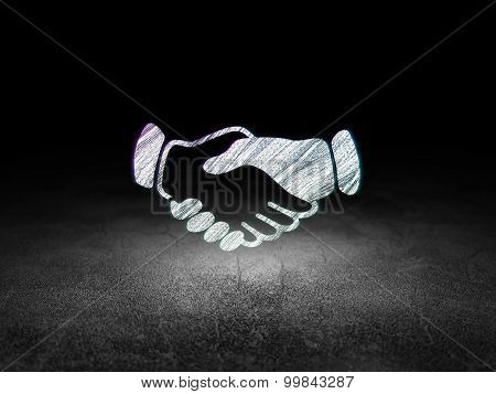 Political concept: Handshake in grunge dark room