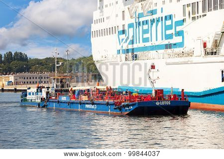 The Fuel Barge In Port