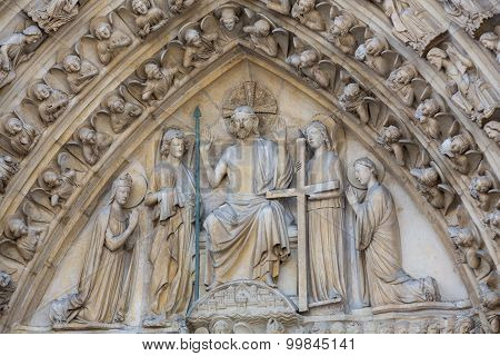 PARIS, FRANCE - SEPTEMBER 8, 2014:Paris - West facade of Notre Dame Cathedral. The Last Judgment portal and tympanum