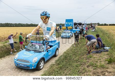 Krys Caravan On A Cobblestone Road- Tour De France 2015