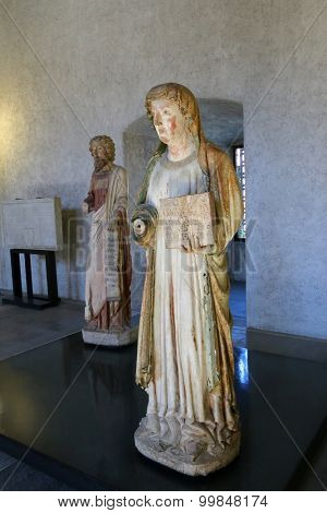 VERONA, ITALY - SEPTEMBER 2014 : Status of  Santa Marta and Saint Bartholomew at Sculpture gallery, Galleria delle sculture, at Castelvecchio Museum in Verona, Italy on September 14, 2014.