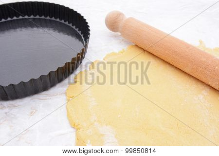 Baking Tin Next To Shortcrust Pastry And Rolling Pin