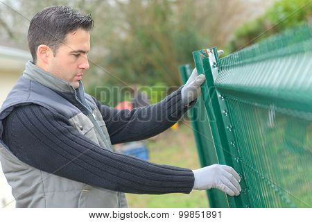 Putting up a metal fence in the garden