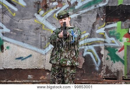 Boy Teenager In A Camouflage And With Equipment For Paintball