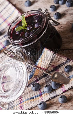 Marmalade Blueberry In A Glass Jar Close Up. Vertical