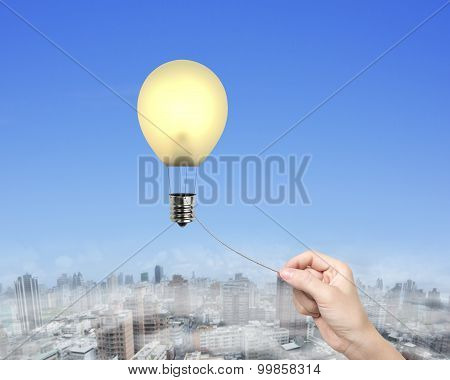 Woman Hand Pulling Rope Connected Lightbulb Hot Air Balloon