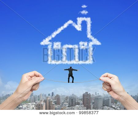 Businessman Balancing Tightrope Woman Hands Holding House Shape Clouds