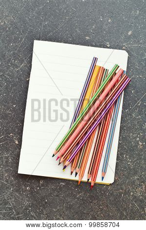 the colour pencils and blank workbook